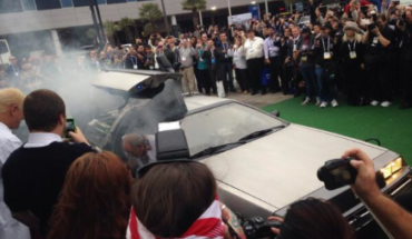 Christopher Lloyd arrives at the Gibson tent in his Delorean time machine.